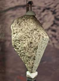 This sample of lunar olivine basalt was collected from the Moon by the Apollo 15 mission. It was formed around 3.3 billion years ago and is now on display in the National Museum of Natural History in Washington, DC, USA.