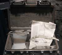 A case used for the transport of lunar samples between the Moon and Earth during the Apollo programme. Inside the case are several sample collection and containment bags, used on the surface for initial sample collection and sorting. These items are on display at the National Museum of Natural History in Washington, DC, USA.
