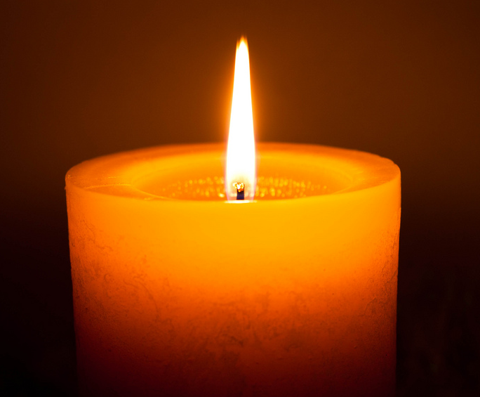 The light emitted by a single candle is roughly equal to one candela, the SI unit of luminosity.