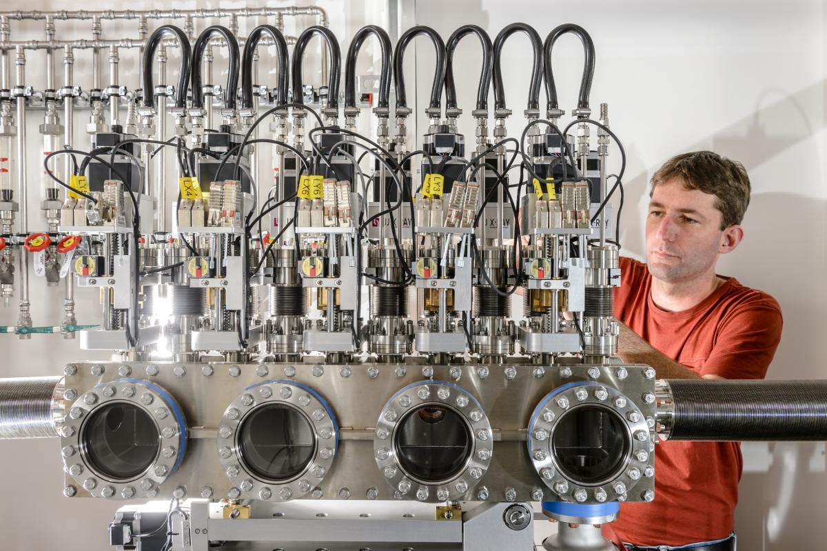 An engineer works on the compound refractive lens (CRL) unit of an instrument at European XFEL.