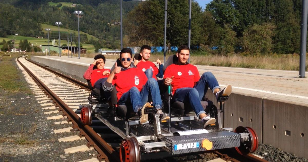 Roberto's students take a trip on the rail rider.