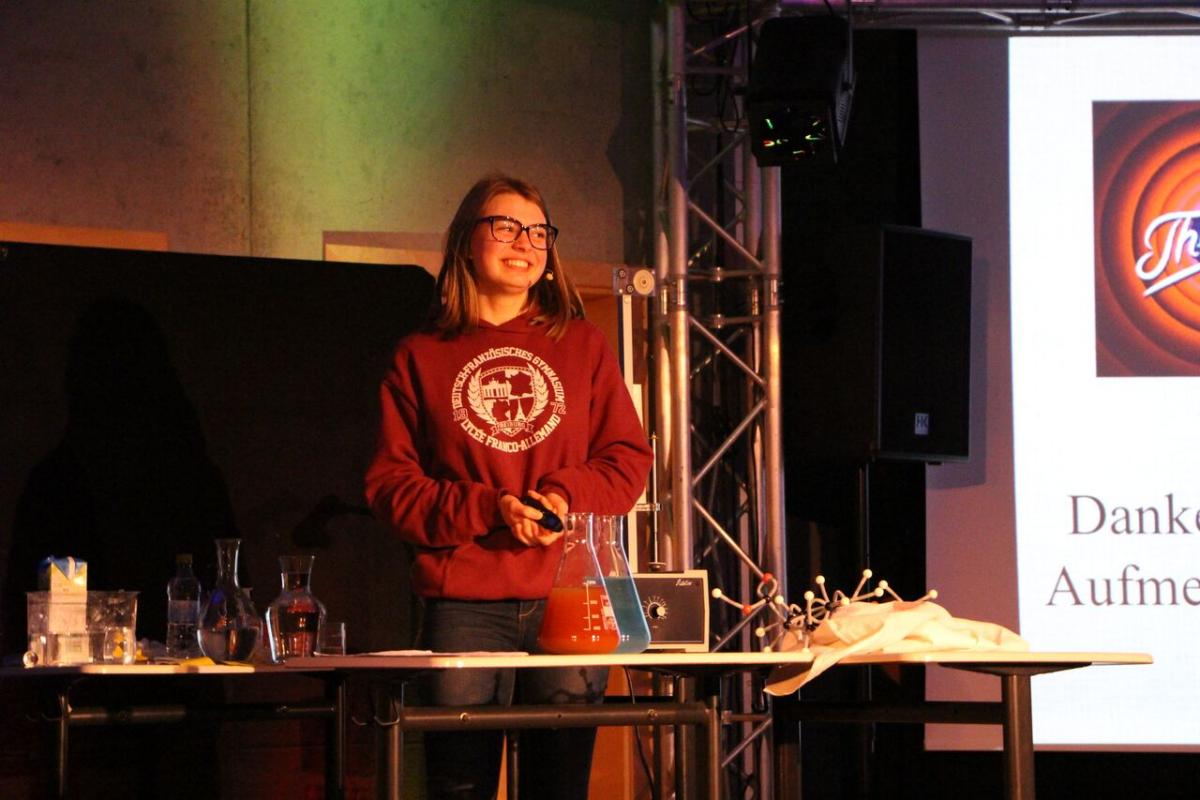 Colourful chemical reactions add extra excitement to this student's talk.
