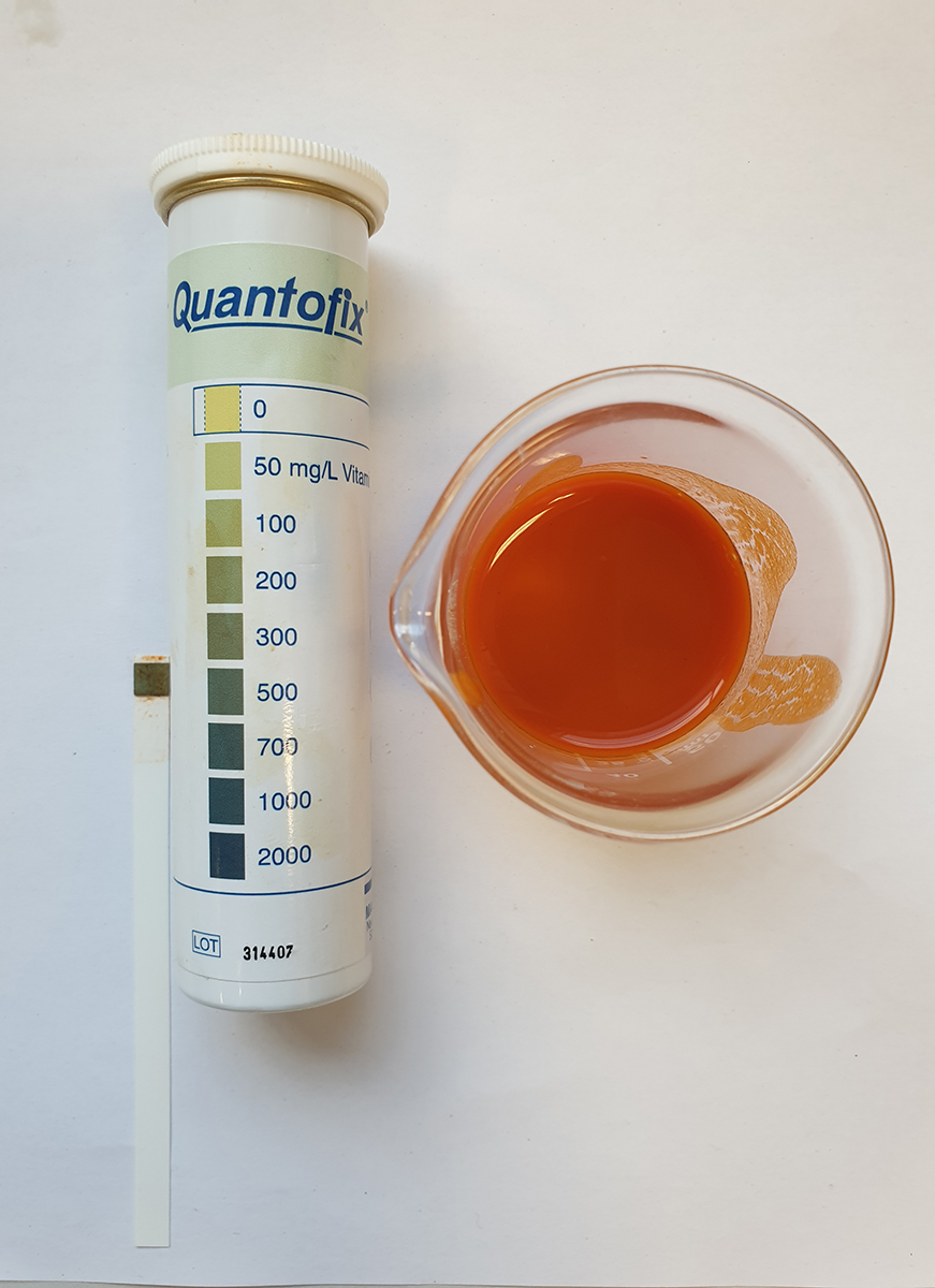 Vitamin C test strip and scale after immersion in goji berry juice