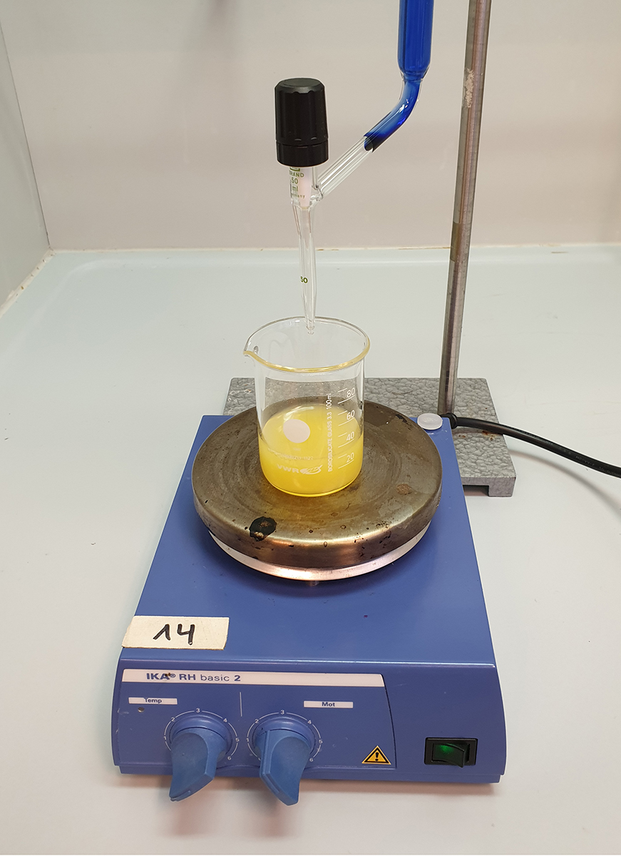 The burette set up for the titration with orange juice