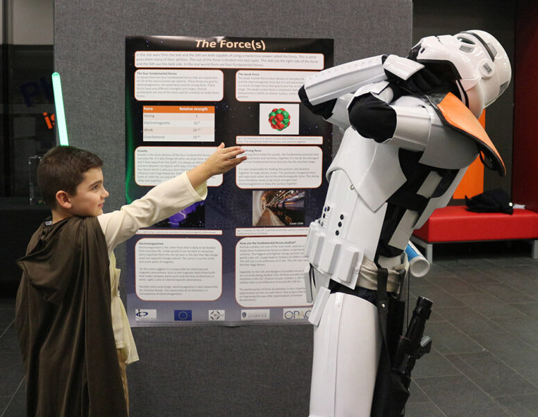 A child dressed as a Jedi attacks stormtrooper using the Force.