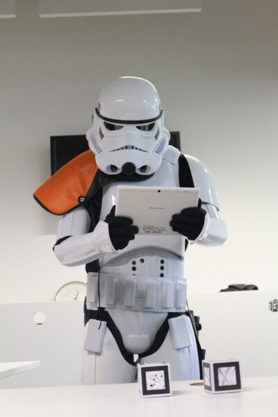 A demonstrator dressed as a stormtrooper using the acceleratAR app on a tablet.
