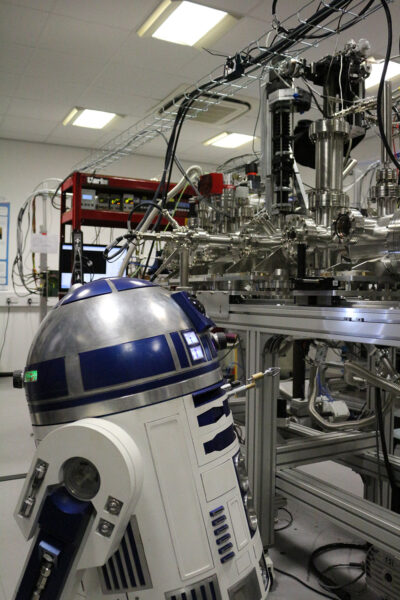 A life-sized R2-D2 model in a laboratory.