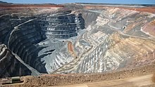 An aerial view of an open-cast gold mine.