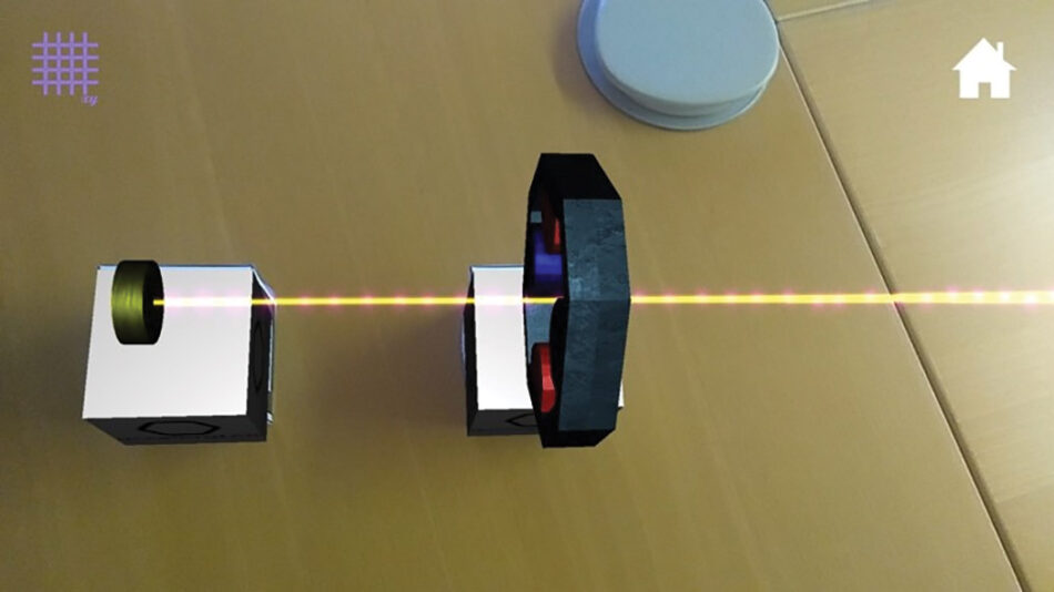 A screenshot of acceleratAR app with the particle source and quadrupole magnet cubes, showing the virtual light beam being focused.